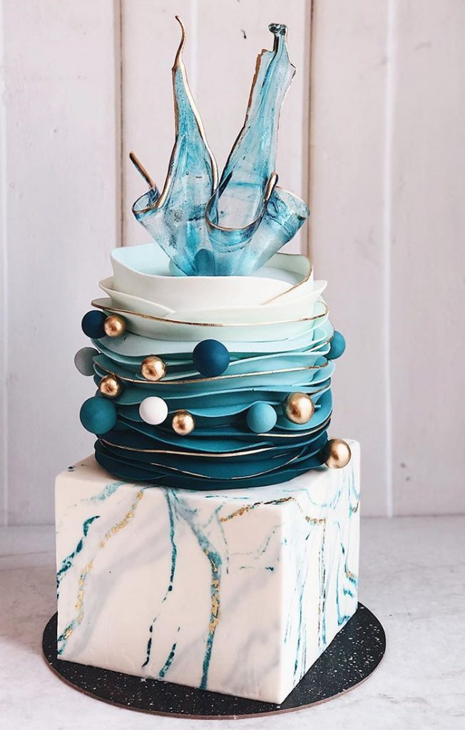 teal-blue-gold-ball-modern-wedding-cake-with-unique-isomalt-cake-topper-652×1024-652×1024